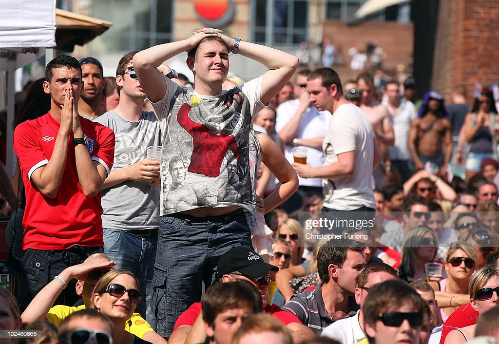 Fans react as they watch England lose 4-1 to Germany on a giant screen in the Manchester fan zone. on June 27, 2010 in Manchester, England. England were knocked out of the FIFA 2010 World Cup competition by 4 goals to 1 in South Africa