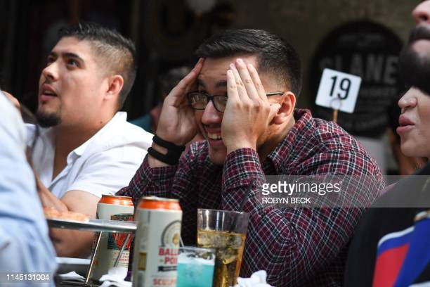 """Fans react as they watch HBO's """"Game of Thrones"""" series finale at a viewing party at Brennan's bar in Marina del Rey, California, May 19, 2019."""