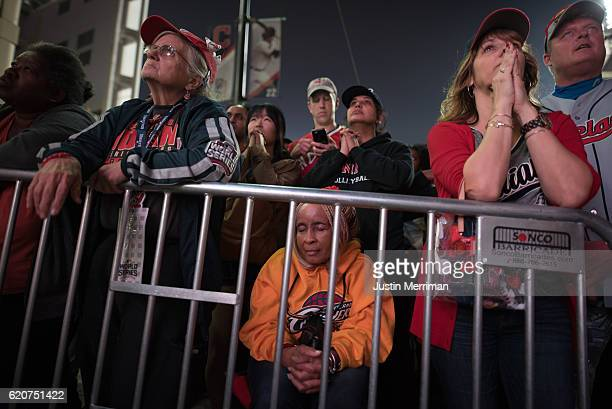 Fans react as they watch the big screen outside of Progressive Field during game 7 of the World Series between the Cleveland Indians and the Chicago...