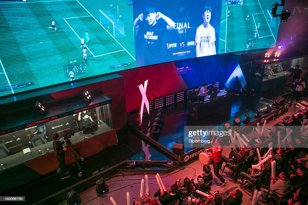 Fans react as they watch the final round of the Electronic Arts Inc. (EA) Sports FIFA Online Championship at the Nexon Co. e-Sports Stadium in Seoul, South Korea, on Saturday, Oct. 17, 2015. Video game competitions, known as eSports, have been expanding as gamers seek to shift perceptions around their craft from a basement hobby to a serious money making industry. Photographer: Jean Chung/Bloomberg via Getty Images