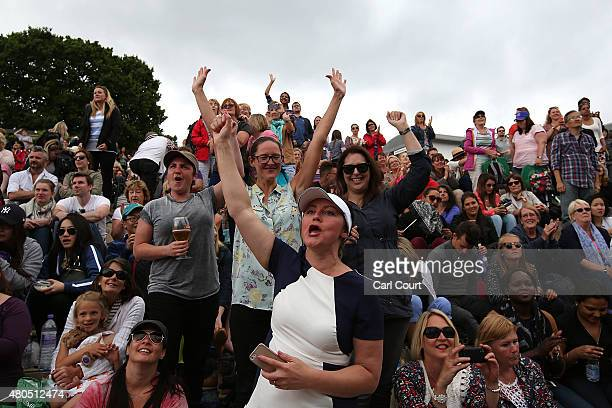 Fans react as they watch the Gentlemen's Singles final match between Novak Djokovic of Serbia and Roger Federer of Switzerland on Murray Mound on day...