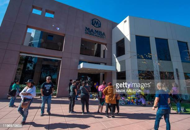Fans react at a memorial for the NBA legend Kobe Bryant outside the Mamba Sports Academy in Thousand Oaks, California on January 27, 2020 after the...