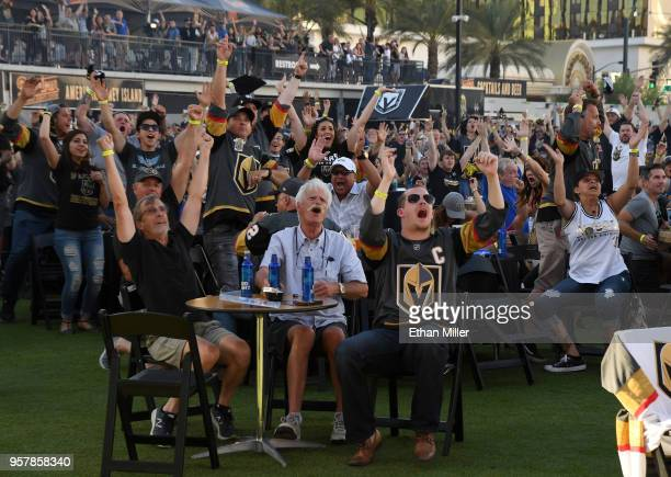 Fans react at a Vegas Golden Knights road game watch party at the Downtown Las Vegas Events Center after William Karlsson of the Vegas Golden Knights...