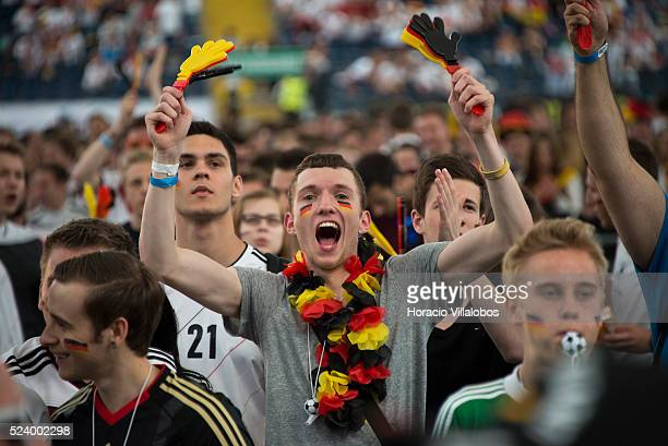 Fans react at the Commerzbank Arena in Frankfurt Germany 16 June 2014 while watching on a giant screen GermanyPortugal soccer match at the 2014 World...