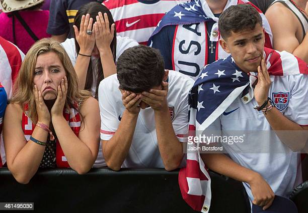 USA fans react at the end of the game as the US soccer looses to Belgium in the World Cup at a viewing party at Redondo Beach Pier in Los Angeles on...