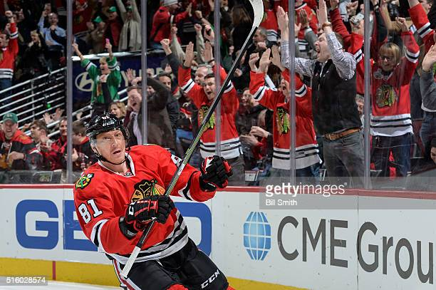 Fans react behind Marian Hossa of the Chicago Blackhawks after he scored on the Philadelphia Flyers in the first period of the NHL game at the United...
