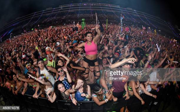 Fans react during a performance by Diplo at the 18th annual Electric Daisy Carnival at Las Vegas Motor Speedway on June 21 2014 in Las Vegas Nevada