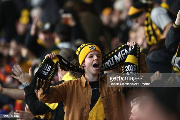 Fans react during the 2017 AFL Grand Final match between the Adelaide Crows and the Richmond Tigers at Melbourne Cricket Ground on September 30 2017...