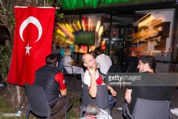 Fans react during the EURO 2020 kick-off match between Turkey and Italy on June 11, 2021 at Leopoldstraße in Munich, Germany.