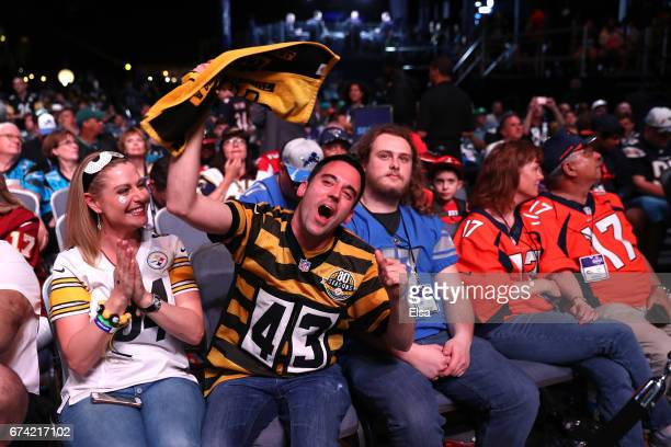 Fans react during the first round of the 2017 NFL Draft at the Philadelphia Museum of Art on April 27 2017 in Philadelphia Pennsylvania