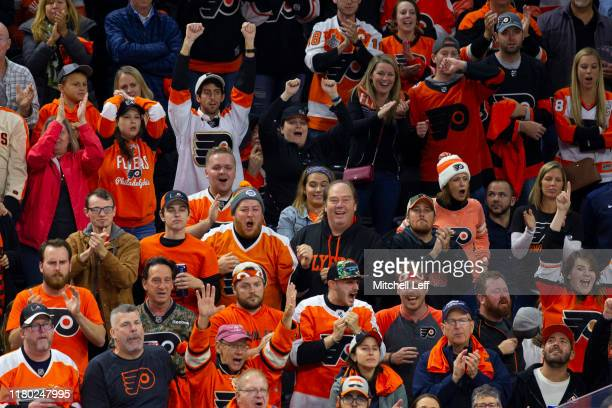 Fans react during the game between the New Jersey Devils and Philadelphia Flyers at the Wells Fargo Center on October 9, 2019 in Philadelphia,...