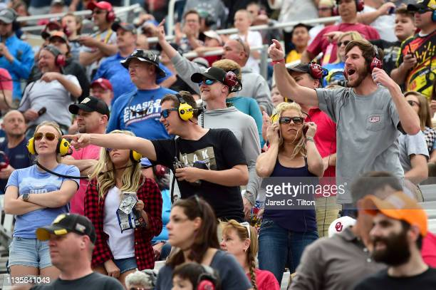 Fans react during the Monster Energy NASCAR Cup Series Food City 500 at Bristol Motor Speedway on April 7 2019 in Bristol Tennessee