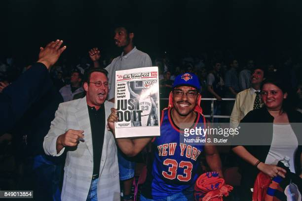 Fans react during the New York Knicks against the Indiana Pacers game during Game Six of the 1999 Eastern Conference Finals on June 11 1999 at...