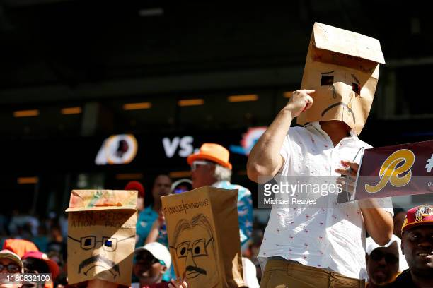 Fans react during the second quarter between the Miami Dolphins and the Washington Redskins at Hard Rock Stadium on October 13 2019 in Miami Florida
