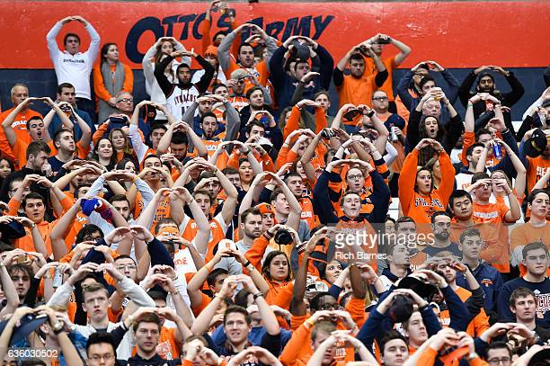 Fans react from the stands during the National Anthem prior to the game between the Georgetown Hoyas and the Syracuse Orange at the Carrier Dome on...