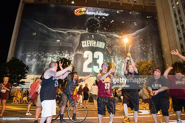 Fans react in downtown Cleveland after the Cleveland Cavaliers won the NBA Championship on June 19 2016 in Cleveland Ohio