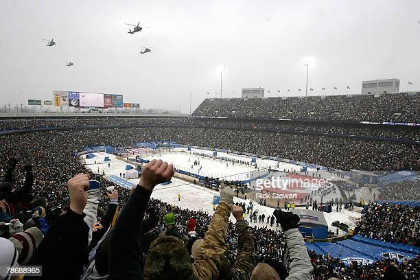 Fans react to a helicopter flyover prior to the 2008 NHL Winter Classic game on January 1 2008 at Ralph Wilson Stadium in Orchard Park New York The...