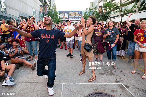 Fans react to a play during the Cleveland Cavaliers NBA Finals Game Seven watch party at Quicken Loans Arena on June 19 2016 in Cleveland Ohio