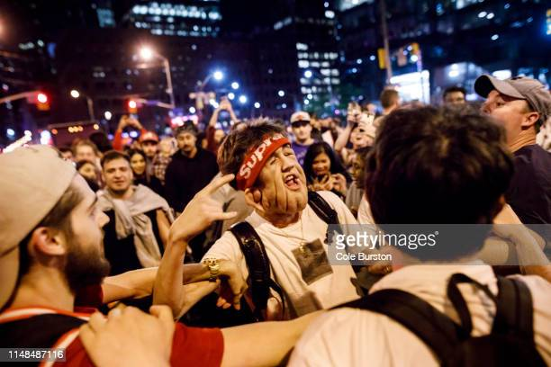 Fans react to a Toronto Raptors win in the streets of Toronto as Raptors fans gather to watch Game 4 of the NBA Finals series outside Scotiabank...