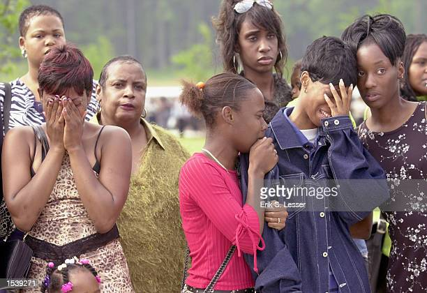 Fans react to arrival of the body of TLC singer Lisa Left Eye Lopes for her public funeral at the New Birth Missionary Baptist Church May 2 2002 in...