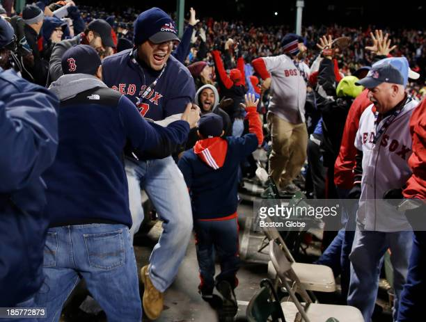 Fans react to David Ortiz's two run home run in the sixth inning of Game Two of the 2013 Major League Baseball World Series between the St Louis...