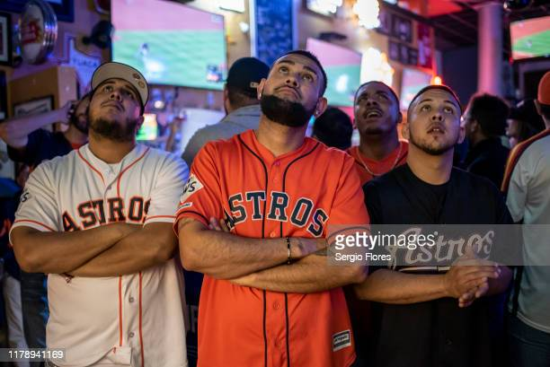 Fans react to game 6 of the World Series between the Houston Astros and The Washington Nationals at Home Plate bar and grill near Minute Maid Park on...