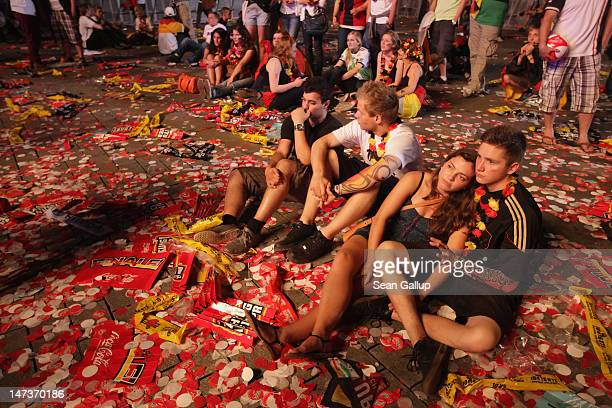 Fans react to Germany's 12 loss against Italy at the Fanmeile public viewing at Brandenburg Gate following the Germany vs Italy UEFA Euro 2012...