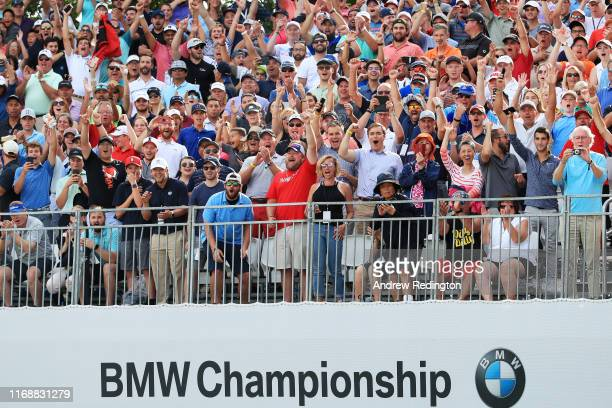Fans react to Justin Thomas of the United States winning during the final round of the BMW Championship at Medinah Country Club No. 3 on August 18,...