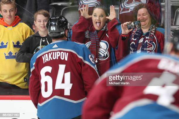 Fans react to Nail Yakupov of the Colorado Avalanche during warm ups prior to the game against the Dallas Stars at the Pepsi Center on December 3...