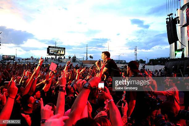 Fans react to singer/guitarist Tim McIlrath of Rise Against performing in the crowd during Rock in Rio USA at the MGM Resorts Festival Grounds on May...