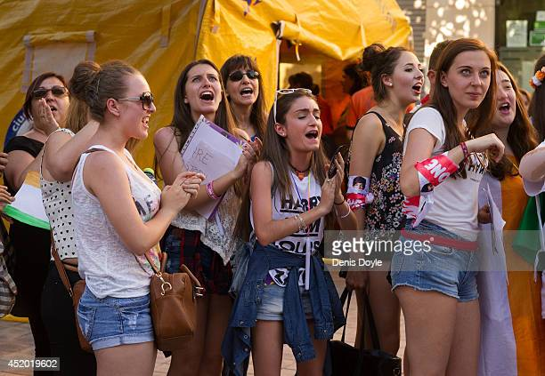 Fans react while waiting outside the Vicente Calderon stadium for the first of two shows by the British and Irish band One Direction on July 10 2014...
