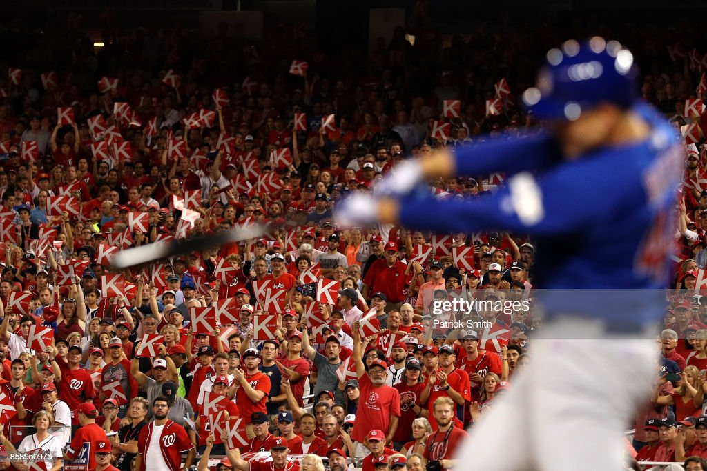 Fans react with 'K' strikeout signs as Anthony Rizzo #44 of the Chicago Cubs swings during the fourth inning against the Washington Nationals in game one of the National League Division Series at Nationals Park on October 6, 2017 in Washington, DC.