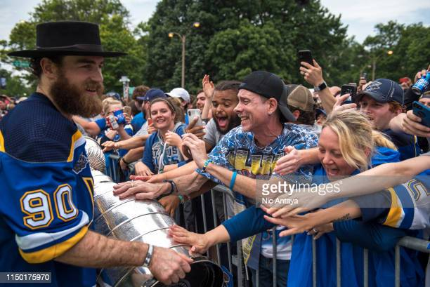 Fans reacts to Ryan O'Reilly of the St. Louis Blues as he holds the Stanley Cup during the St Louis Blues Victory Parade and Rally after winning the...