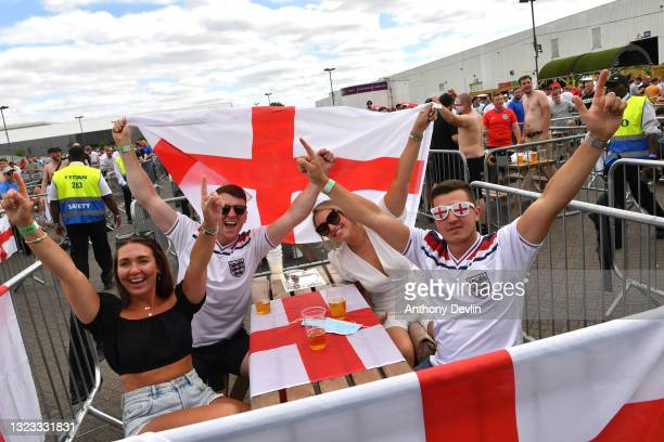 Fans reacts to the camera as they sit in socially distanced areas at the 4TheFans Secret City fan zone at Event City on June 13, 2021 in Manchester,...