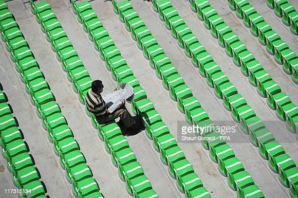 A fans reads the paper before the FIFA U17 World Cup Group C match between Uruguay and England at Estadio Torreon on June 25 2011 in Torreon Mexico