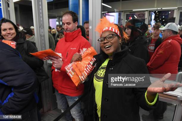 Fans receive an orange hairpiece to celebrate Montreal Canadiens mascot Youppi 40th birthday prior to the NHL game between the Montreal Canadiens and...