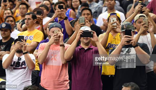 Fans record images on cell phones as the Boston Celtics and the Los Angeles Lakers take the court before a 2017 Summer League game at the Thomas Mack...