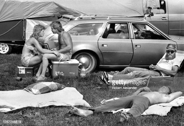 Fans relax in the speedway infield prior to the start of the 1980 Daytona 500 stock car race at Daytona International Speedway in Daytona Beach,...