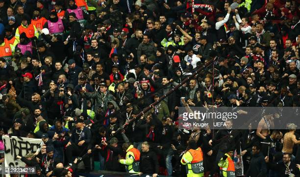 PSG fans remove the safety netting during the UEFA Champions League Round of 16 First Leg match between Manchester United and Paris SaintGermain at...