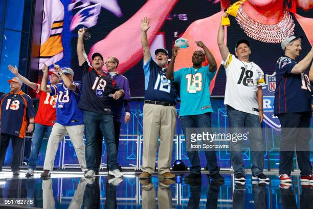 Fans represent their teams on stage prior to the first round of the NFL Draft on April 26, 2018 at AT&T Stadium in Arlington, TX.