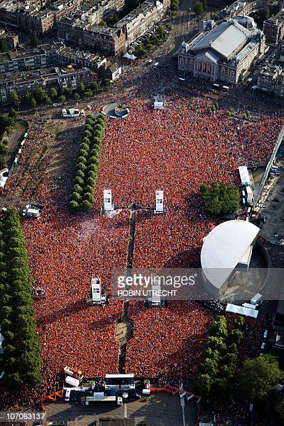 Fans reunite at Amsterdam's Museum Square to watch the match on giant screens and in surrounding cafes on July 11 2010 during the 2010 FIFA World Cup...