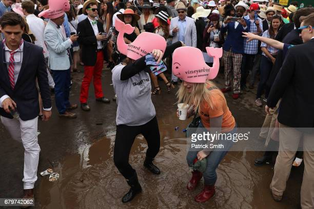Fans revel in the infield prior to the 143rd running of the Kentucky Derby at Churchill Downs on May 6, 2017 in Louisville, Kentucky.