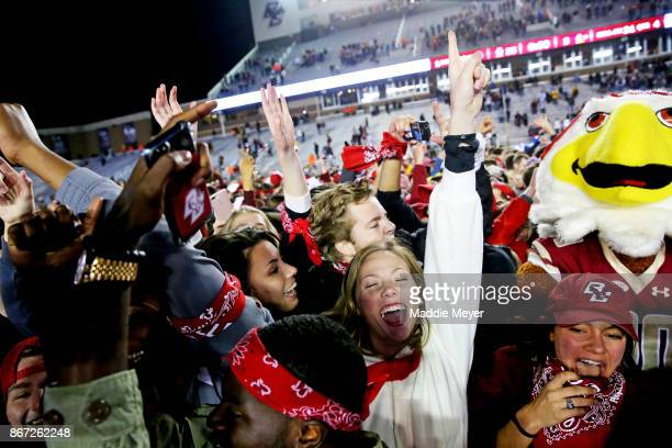 Fans rush the field after the Boston College Eagles defeat the Florida State Seminoles 353 at Alumni Stadium on October 27 2017 in Chestnut Hill...