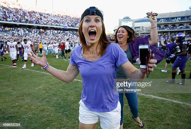 Fans rush the field after the TCU Horned Frogs beat the Oklahoma Sooners 3733 at Amon G Carter Stadium on October 4 2014 in Fort Worth Texas