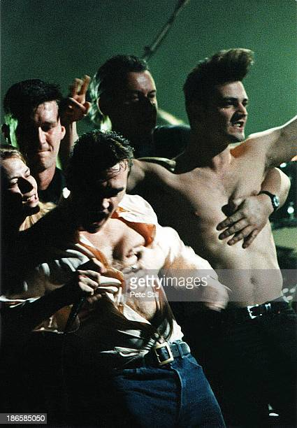 Fans rush the stage while Morrissey performs in concert at the Theatre Royal Drury Lane during his 'Boxer' tour on February 26th 1995 in London...