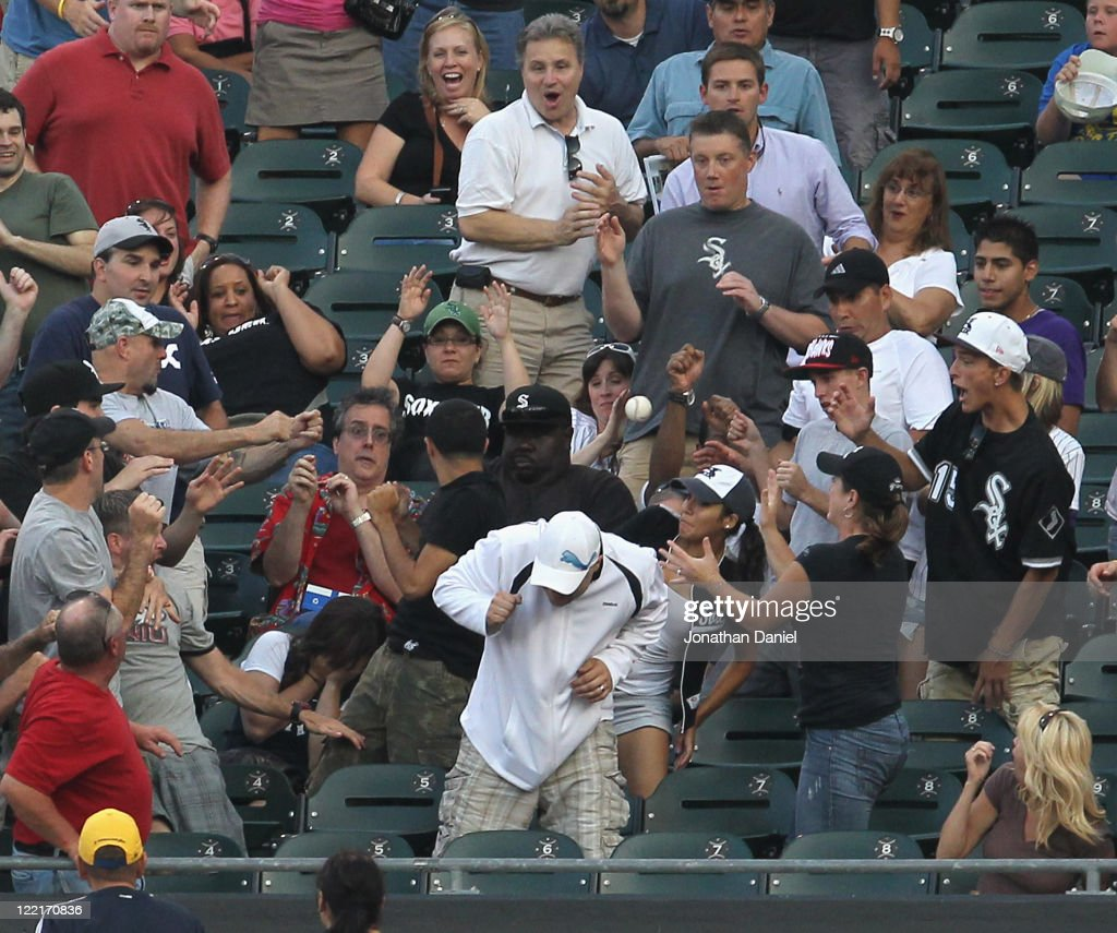 Fans scramble for a home run ball during a game against between the New York Yankees and the Chicago White Sox at U.S. Cellular Field on August 3, 2011 in Chicago, Illinois.The Yankees defeated the White Sox 18-7.