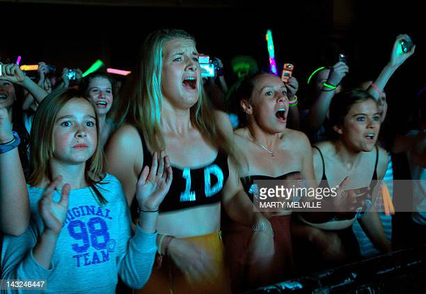Fans scream as the BritishIrish boy band One Direction performs during the group's concert at the St James theatre in Wellington on April 22 2012 One...