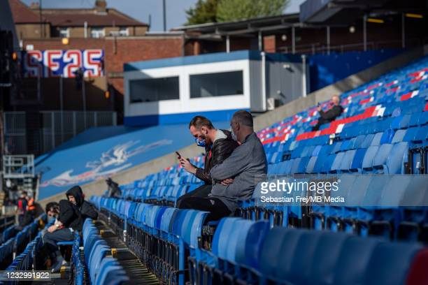 Fans seating at stadium during the Premier League match between Crystal Palace and Arsenal at Selhurst Park on May 19, 2021 in London, United...