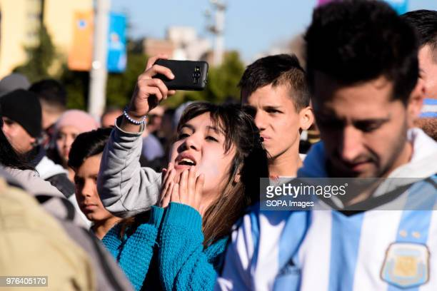 Fans seen in the square watching the large TV during the football game Thousands of football fans took to the main square in Buenos Aires to see the...