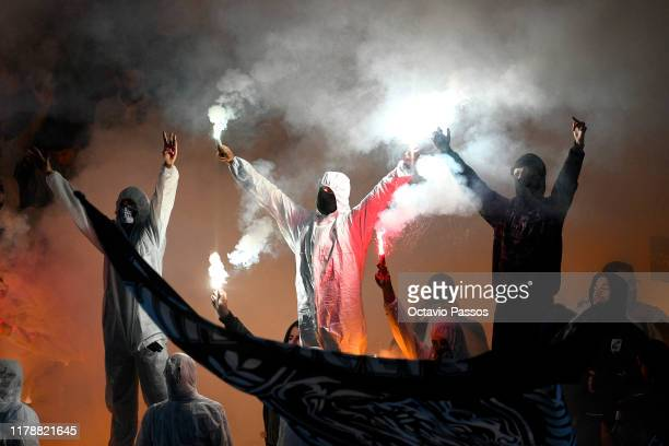 Fans set flares off inside the stadium during the UEFA Europa League group F match between Vitoria Guimaraes and Eintracht Frankfurt at Estadio Dom...